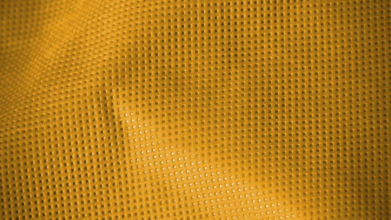 A textural, bright yellow nonwoven textile.