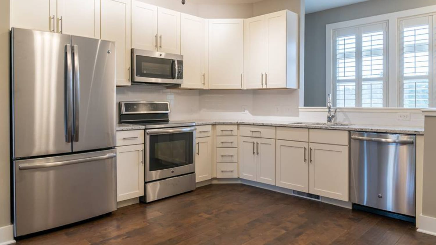 A kitchen with shiny new appliances at North Shore, a townhome complex on Centennial Campus.