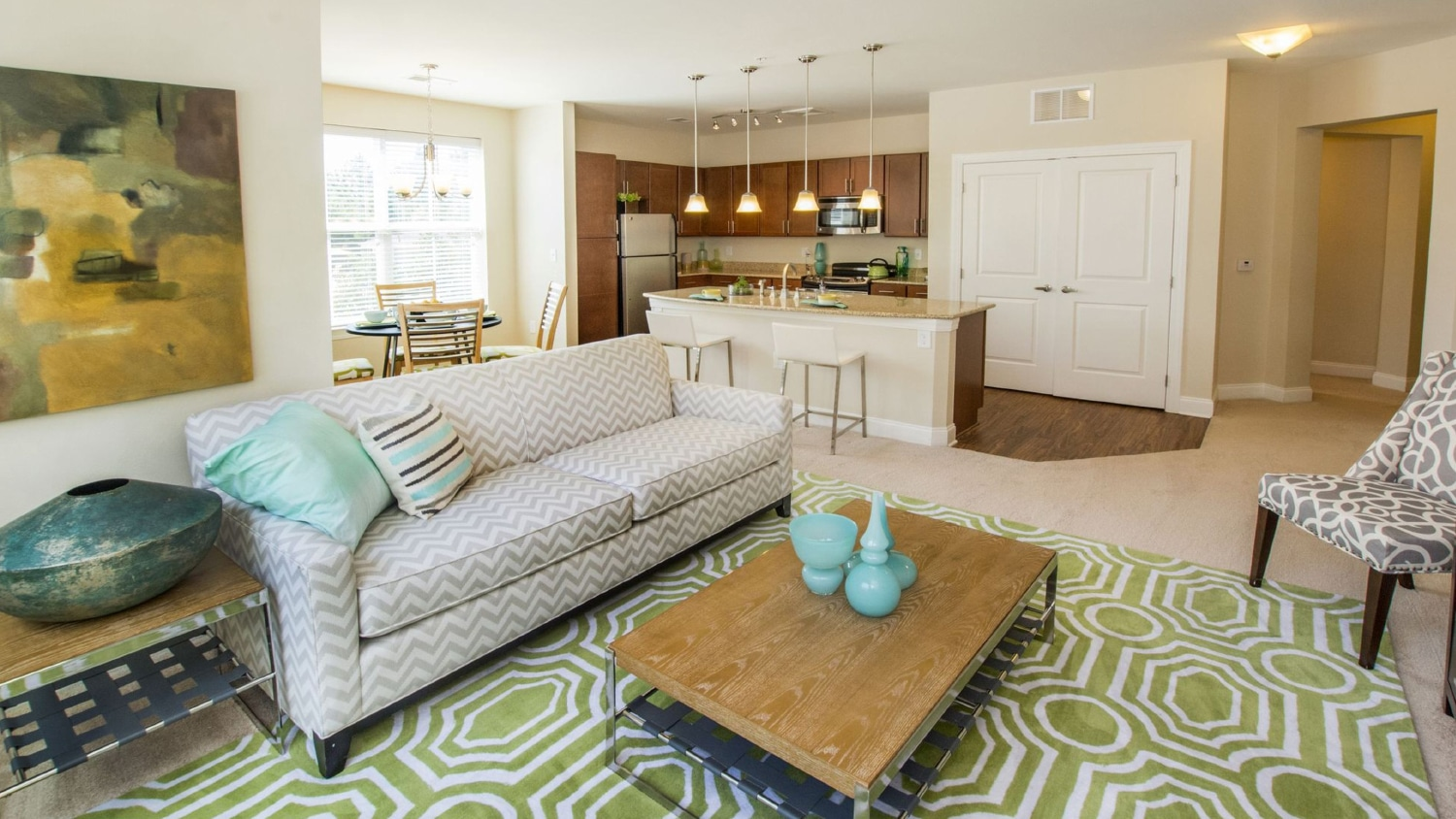 A well-appointed living room in The Greens at Centennial, an apartment community.