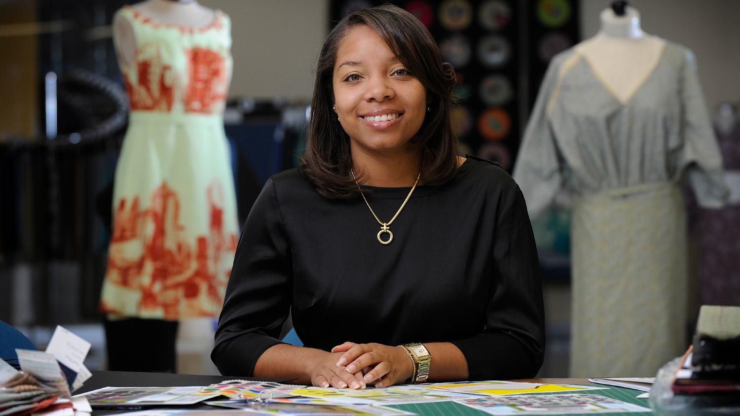 A fashion designer works on her boutique clothing line.