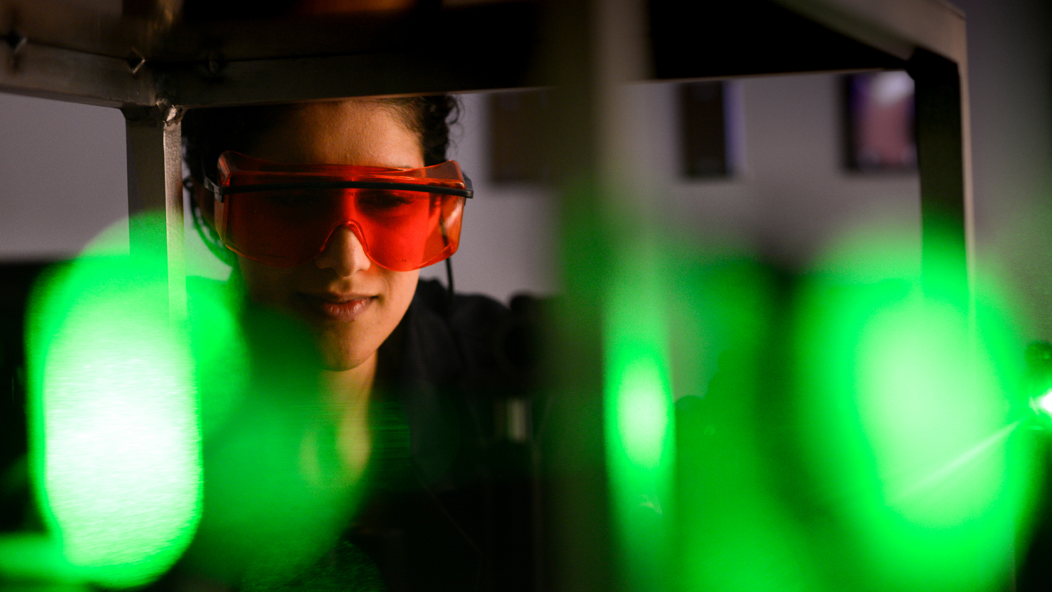 A researcher studies lasers.