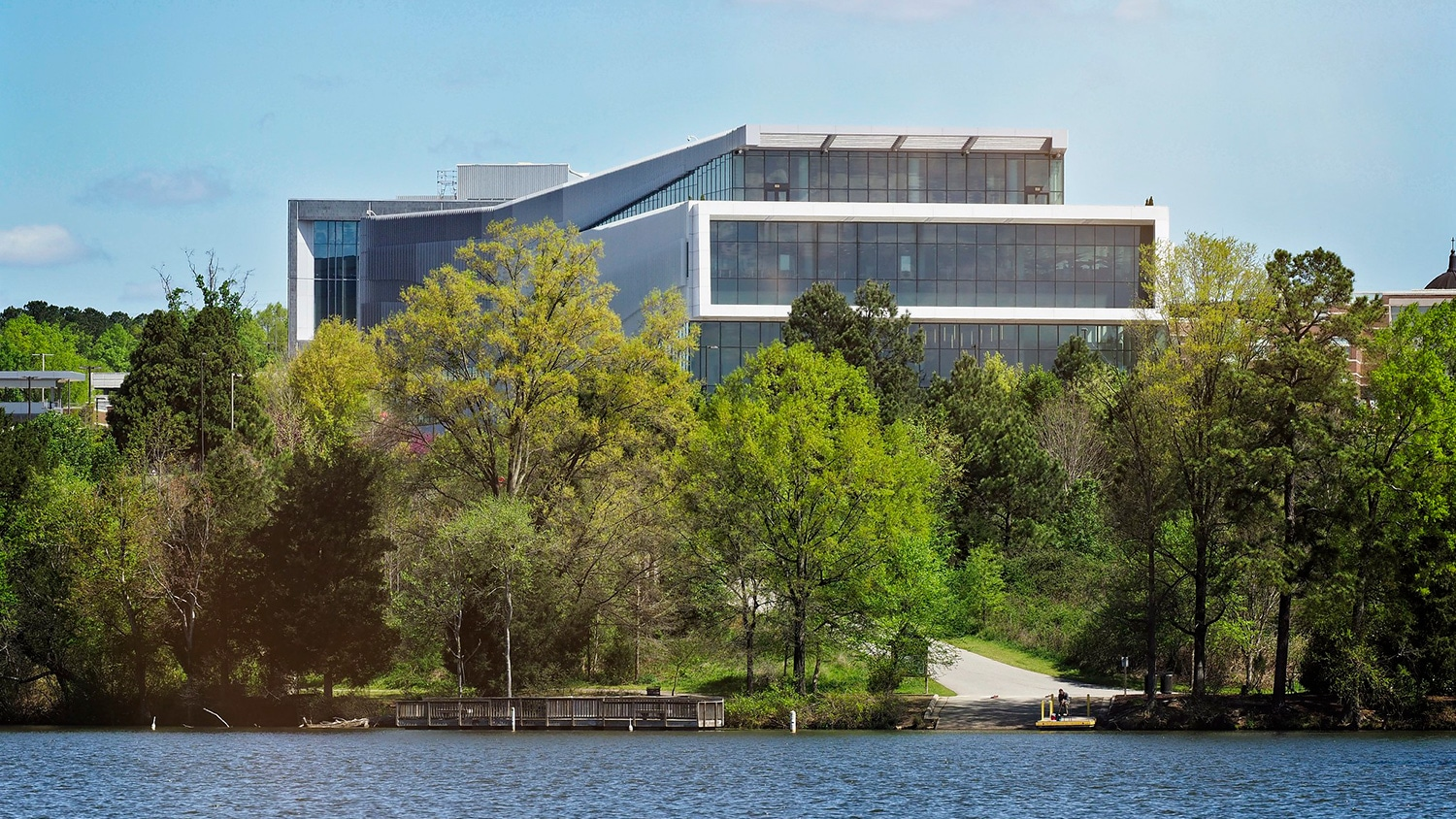 Hunt Library overlooking Lake Raleigh on a sunny spring day.