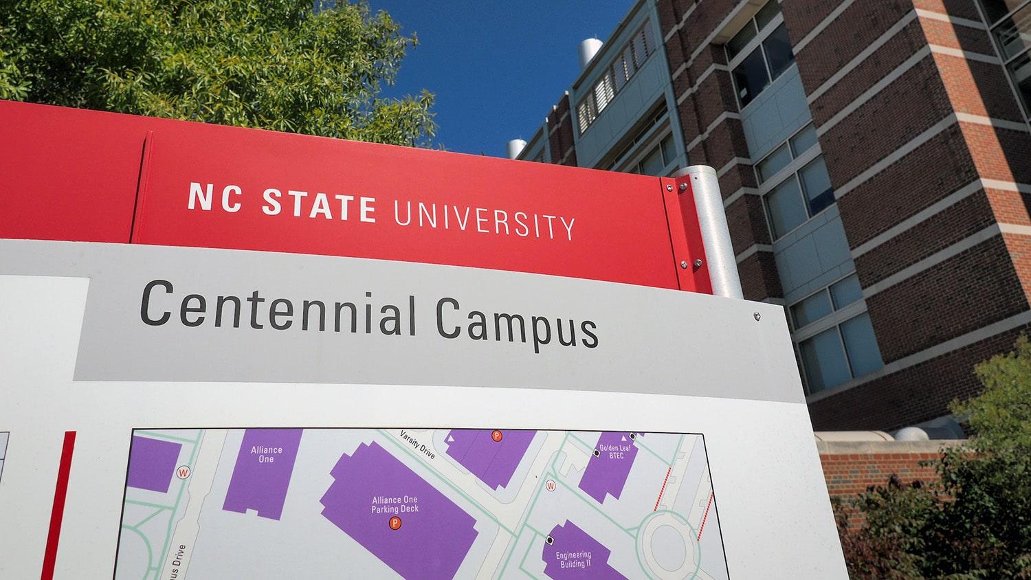 A directional sign (map) helps orient visitors to Centennial campus. In the background is Engineering building 1.